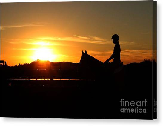 Riding At Sunset Canvas Print