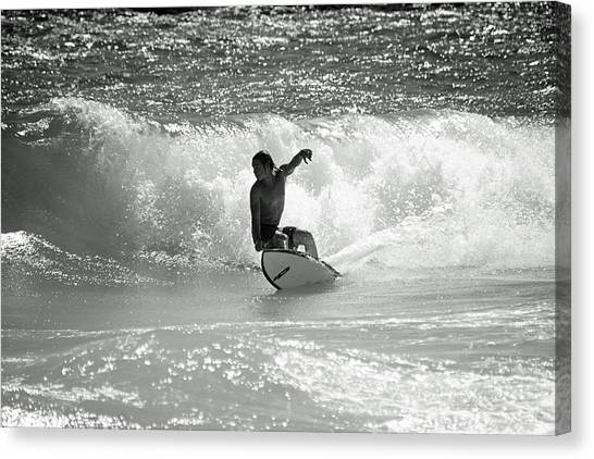 Riding The Waves Canvas Print by Thomas Fouch