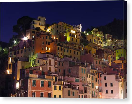 Riomaggiore Buildings At Night Canvas Print by Ioan Panaite