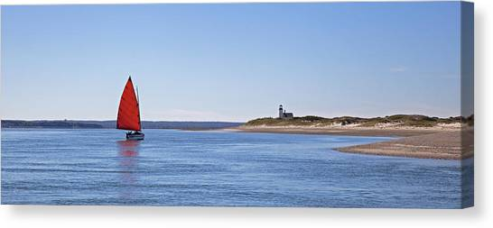 Ripple Catboat With Red Sail And Lighthouse Canvas Print