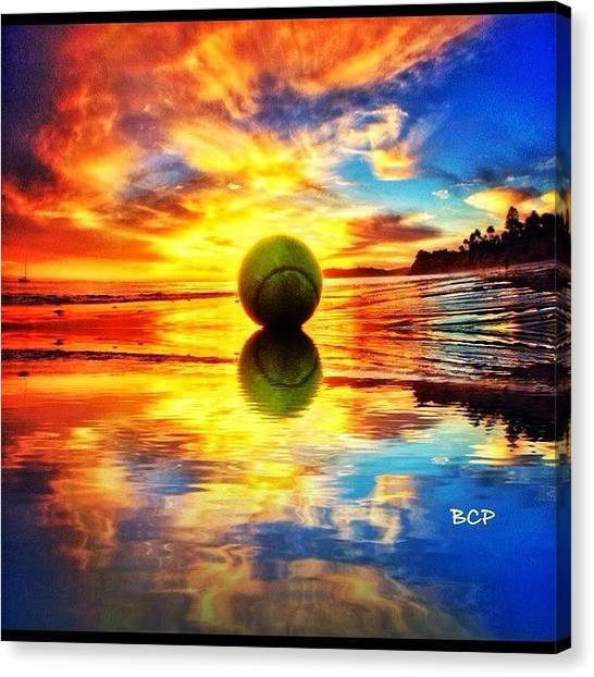 Tennis Ball Canvas Print - Rising #sun #tennis #ball #beach #ocean by Brett Connors