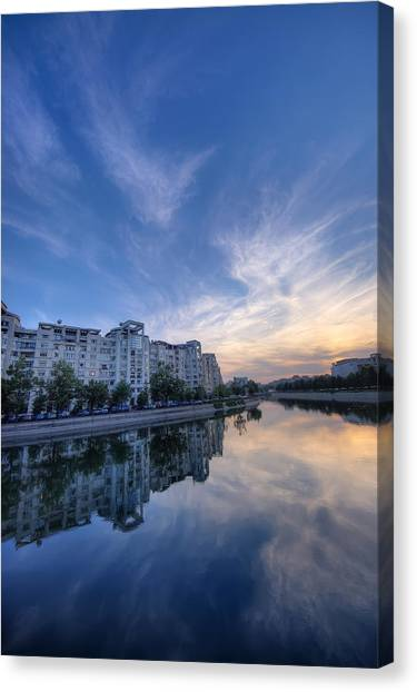 River In City At Sunset Canvas Print by Ioan Panaite