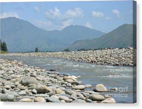 Riverbank Water Rocks Mountains And A Horseman Swat Valley Pakistan Canvas Print