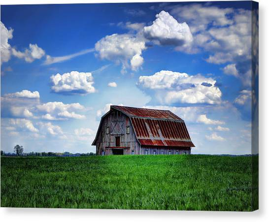 Riverbottom Barn Against The Sky Canvas Print