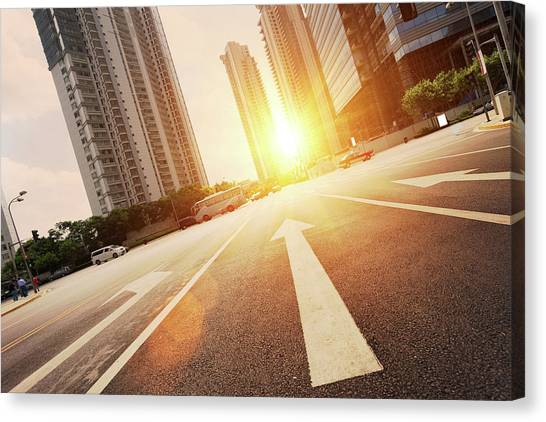 Road In City With Sunset Canvas Print by Loveguli