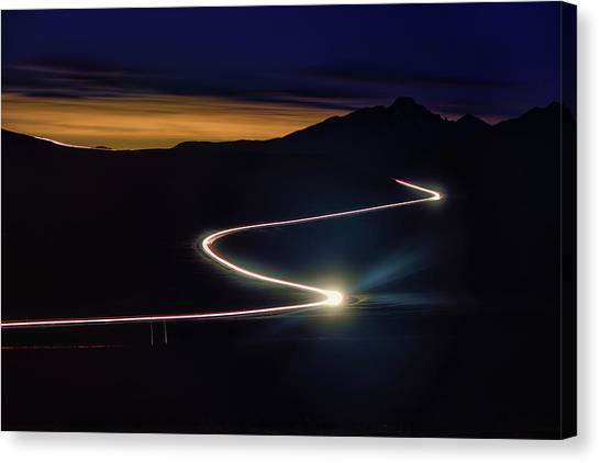 Canvas Print - Road With Headlights In Rocky Mountain by Keith Ladzinski