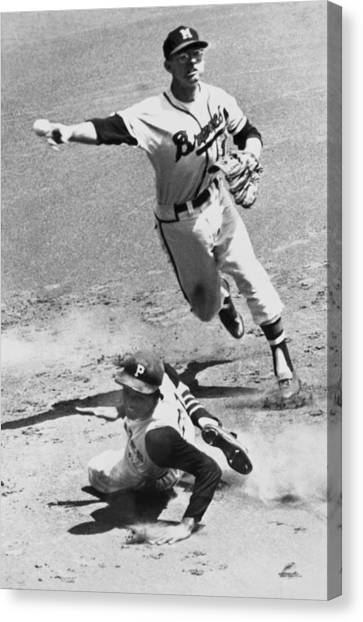 Roberto Clemente Canvas Print - Roberto Clemente Sliding by Underwood Archives