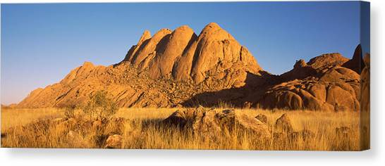 Namib Desert Canvas Print - Rock Formations In A Desert At Dawn by Panoramic Images
