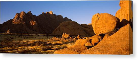 Namib Desert Canvas Print - Rock Formations In A Desert by Panoramic Images