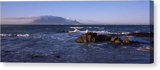 City Sunrises Canvas Print - Rocks In The Sea With Table Mountain by Panoramic Images
