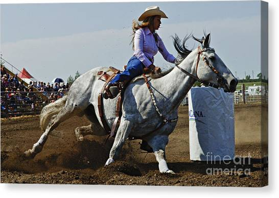Barrel Racing Canvas Print - Rodeo Barrel Racer by Bob Christopher