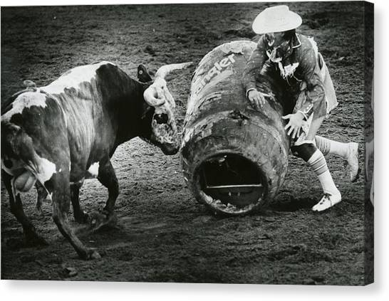 Rodeo Clown Canvas Print - Rodeo Bull And Clown Fight by Retro Images Archive