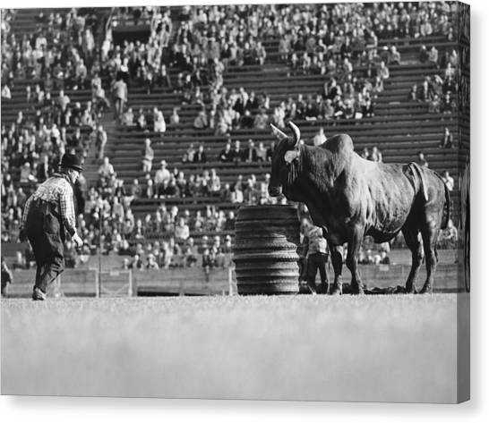 Rodeo Clown Canvas Print - Rodeo Clown Watches Bull by Otto Rothschild