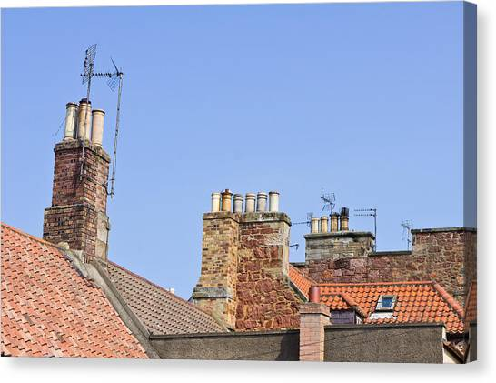 Chimney Tops Canvas Print - Rooves And Chimneys by Tom Gowanlock