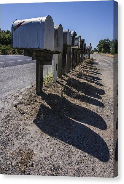 Row Of Mailboxes And Shadows Canvas Print by David Litschel