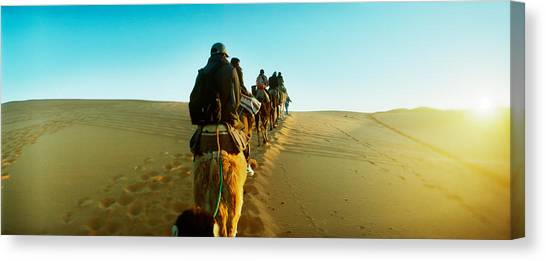 Sahara Desert Canvas Print - Row Of People Riding Camels by Panoramic Images