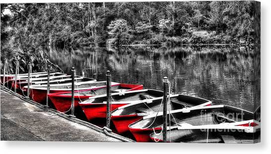 Row Of Red Rowing Boats Canvas Print
