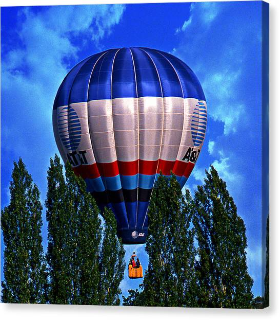 Running The Tree Tops Canvas Print by Ken Evans