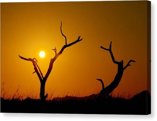 Prairie Sunsets Canvas Print - Sacrifice by Chad Dutson