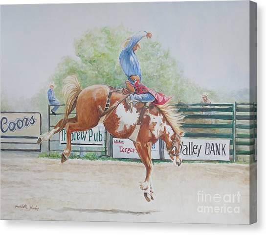 Saddle Bronc Canvas Print by Charlotte Yealey