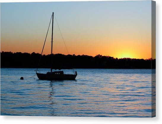 Sailboat Moored At Sunset Canvas Print