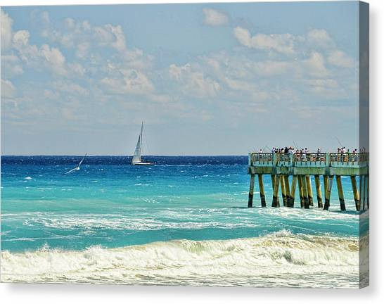 Sailing By The Pier Canvas Print