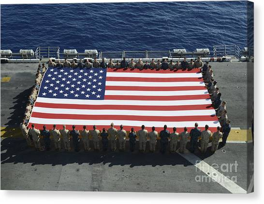 Canvas Print featuring the photograph Sailors And Marines Display by Stocktrek Images