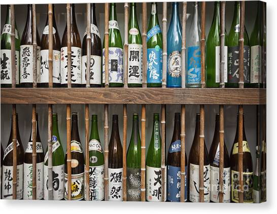 Canvas Print featuring the photograph Sake Bottles by Bryan Mullennix