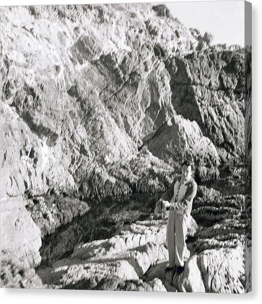 Salvador Dali Canvas Print - Salvador Dali On Rocks by Horst P. Horst