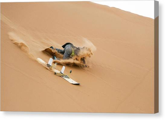 Sand-boarding The Saharan Sand Dunes, Merzouga, Morocco Canvas Print by Paul Biris