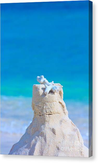 Sand Castle With Coral Against Calm Turquoise Sea Canvas Print
