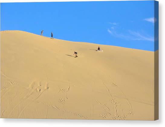 Sand Surfing In The Dunes Near Huacachina, Peru Canvas Print by Markus Daniel