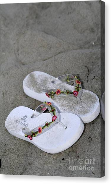Sandals In The Sand Canvas Print by Laura Paine