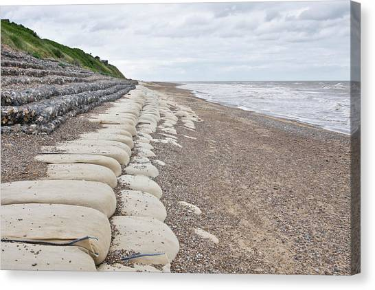 Beach Cliffs Canvas Print - Sandbags On Beach by Tom Gowanlock