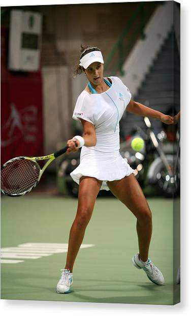 Tennis Pros Canvas Print - Sania Mirza On The Ball In Doha by Paul Cowan