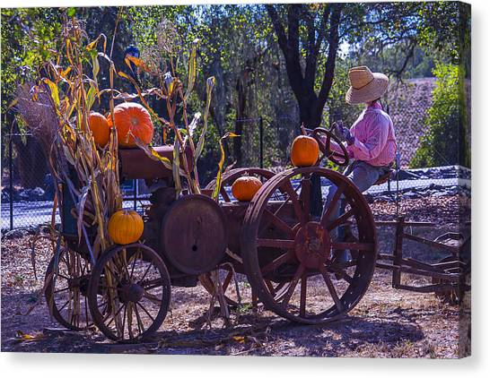 Scarecrows Canvas Print - Scarecrow Sitting On Tractor by Garry Gay