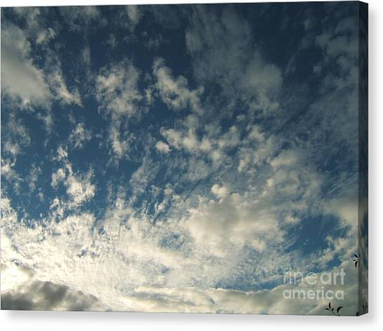 Scattered Clouds Canvas Print by Margaret McDermott