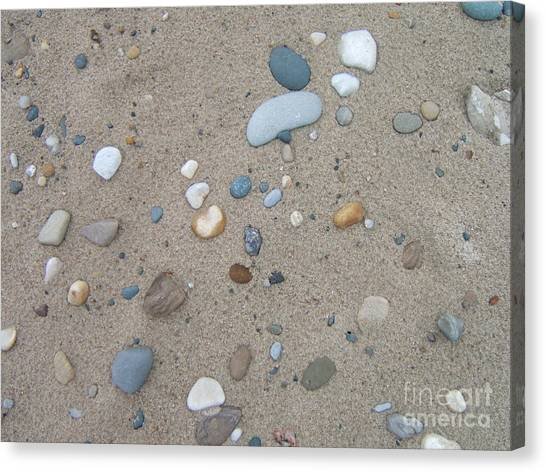Scattered Pebbles Canvas Print by Margaret McDermott
