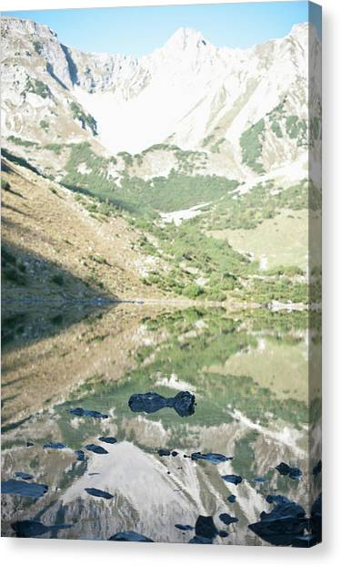 Scenic View Of Mountains And Lake Canvas Print by Mark Gerum