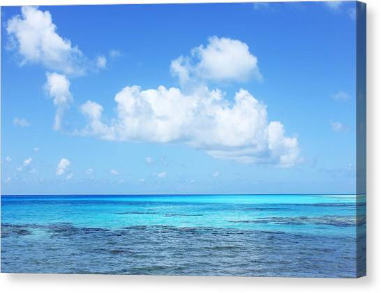 Scenic View Of Turquoise Sea Against Sky Canvas Print by Fred Bahurlet / Eyeem