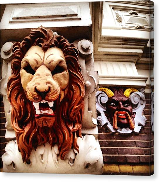 Jaws Canvas Print - Sculptures On An Amsterdam House by REO De Jongh