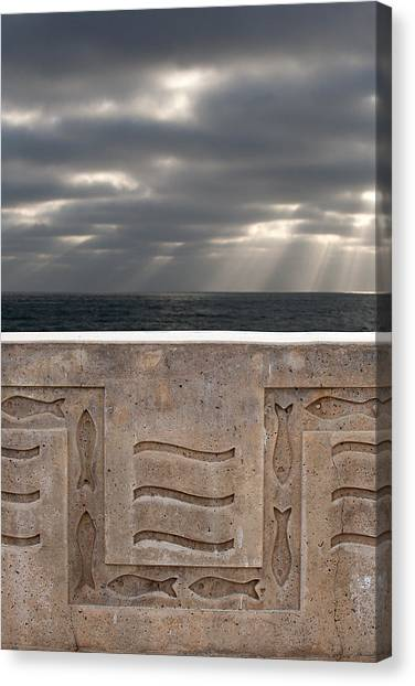 Sea Walls And Light Shafts Canvas Print by Peter Tellone
