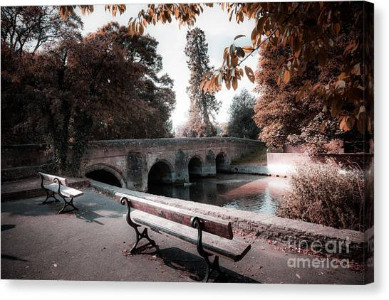 Seats By The River Canvas Print