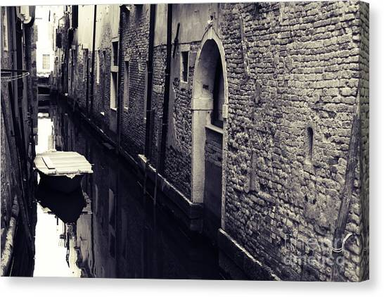 Secluded Canal In Venice Canvas Print by Ernst Cerjak