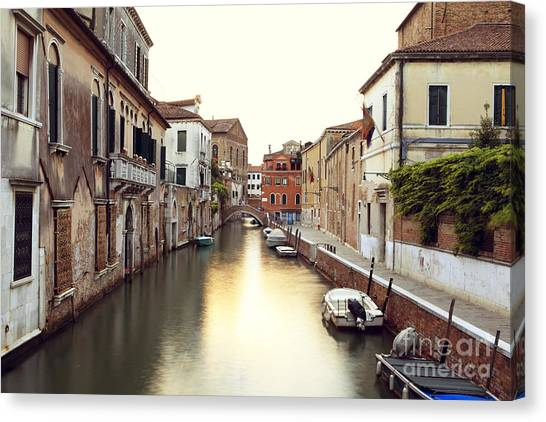 Secluded Canal In Venice Italy Canvas Print by Ernst Cerjak