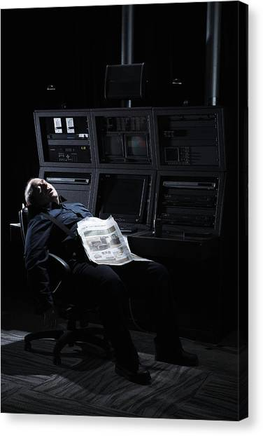 Security Guard Asleep In Office Canvas Print by Thomas Northcut