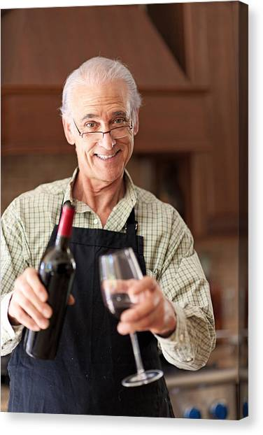 Senior Man Having A Glass Of Wine Canvas Print by Lise Gagne