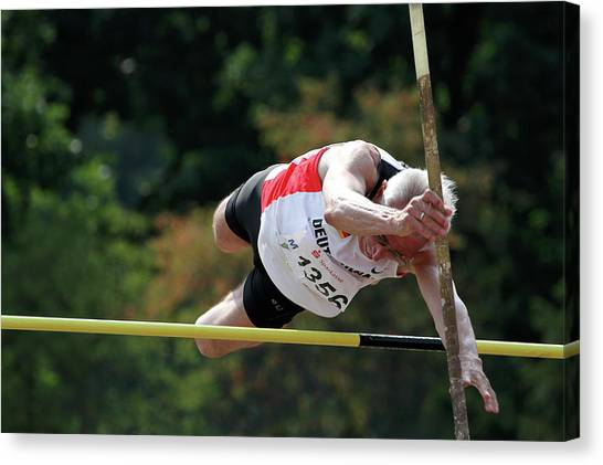 Just Do It Canvas Print - Senior Pole Vaulter Clearing The Bar by Alex Rotas