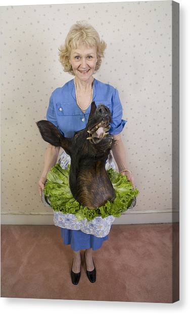 Senior Woman Holding Wild Boars Head, Portrait, High Angle View Canvas Print by Sheer Photo, Inc