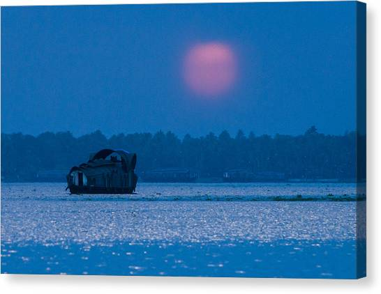 Setting Sun And Boat Canvas Print